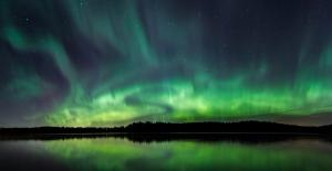 Northern Lights over Lappish Forest