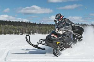 Tourist on a snowmobile