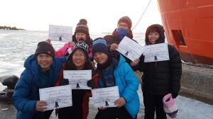Tourists with their certificates